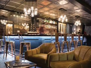 Mixed levels and types of seating encourage socializing at Charlotte's Speakeasy on Long Island. Image courtesy of Harriet Andronikides Photography