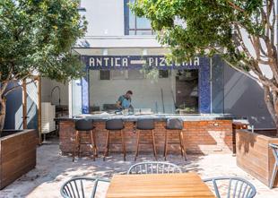 The courtyard at L'Antica Pizzeria da Michele features an open pizza bar.